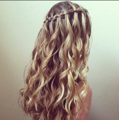 Wow, this is pretty. This is a waterfall braid with curly hair. I have naturally straight hair so if I want to do this I'll have to curl my hair... Oh well it'll be worth it!