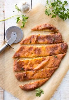 A tasty low carb garlic bread made with the famous Fat Head (mozzarella) dough. Grain free, keto, gluten free and perfect for snacking!