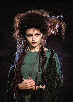 Helena Bonham Carter as Morgan Le Fay in Merlin (TV film). Love the green. Contrary to her typical portrayal, in medieval literature Morgana is a truth seeker and healer, the nemesis of Guinevere, not Arthur.