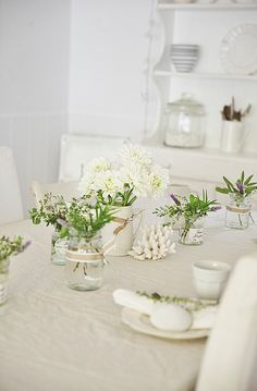 beach cottage white table decor with herbs, summer flowers abeachcottge.com