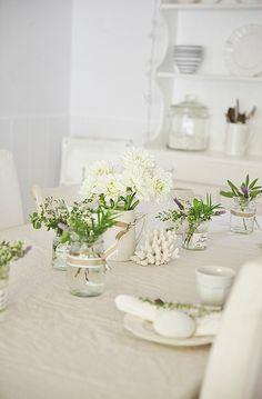 beach cottage white table decor with herbs, summer flowers abeachcottge.com