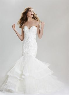 Sweetheart beaded floral lace mermaid gown with tiers of horsehair edged tulle. Ruffles www.labelleelaines.com