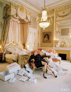 Boxed Out - Karl Lagerfeld took over the first-floor-spanning Imperial Suite, seen here, for his 1996 couture collection. Chanel Haute Couture embroidered organza flower coat and pumps.