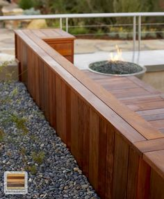Ipe wood decking and fire pit.  Could this be worked into retaining wall??