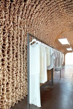 Twenty-five thousand brown paper lunch bags line the wall and ceiling of OWEN, a new fashion boutique in New York's Meatpacking District by Jeremy Barbour of Brooklyn architects Tacklebox.