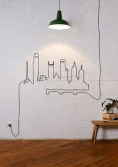 Home what a great idea for all those ugly hanging wire problem. ---- If I was a little bit craftier I would do this in the shape of the Philadelphia skyline!