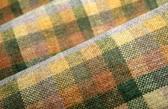 Cabin Fever Upholstery in Santa Fe is a cotton blend chenille plaid made in the USA. Find it at FabricSeen for 83% off the design center price at $36 per yard.