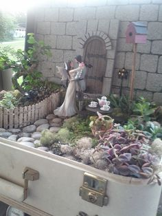 fairy garden in a vintage suitcase. This is my mom's creation for my sister's wedding. The picture doesn't do it justice