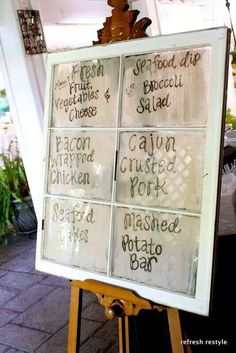 Buffet style weddings: Dry erase marker on antique style windows to display the menu.