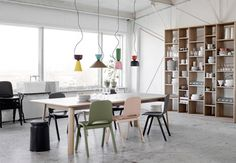 Lamp comprising colourful shades that stack in customisable combinations.