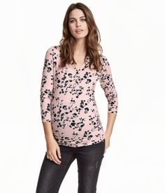 Check this out! Long-sleeved top in soft jersey with a gentle drape. V-neck and button placket. Elastication at sides for improved fit. - Visit hm.com to see more.