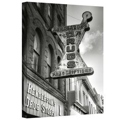 Steve Ainsworth 'Drug Store Sign' gallery-wrapped canvas depicts a retro signs…