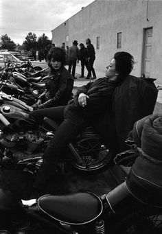 """Bill Ray definitely has a few of his own favorite pictures from his time with the Angels. """"One,"""" he says, """"is the picture of Ruthie at the jukebox. Another is this photo taken outside the bar as the sun sinks, with the old lady leaning back on the bike, smoking a cigarette."""