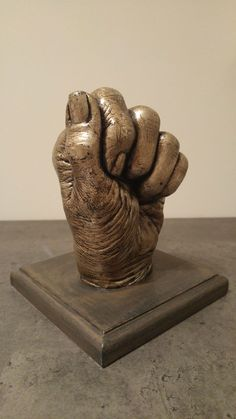 A hand from a 71 years old woman. Covered with aluminium leaf and patinated with oil colour. Made by UlNiTo