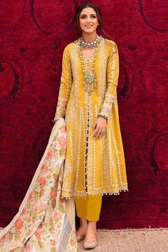 Get gorgeous in this yellow cotton trouser suit which will certainly make you rule to the party. This v neck and full sleeve clothe designed using thread work. Accompanied by a matching santoon cigarette pant in yellow color and off white net dupatta. Cigarette pant is plain. #trousersuit #salwarkameez #malaysia #Indianwear #Indiandresses #andaazfashion