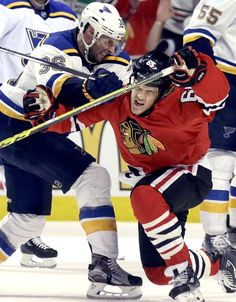 Physical play:    Chicago Blackhawks right wing Andrew Shaw is hit by St. Louis Blues right wing Troy Brouwer during Game 4 of their playoff series on April 19 in Chicago.  -     © Nam Y. Huh/AP