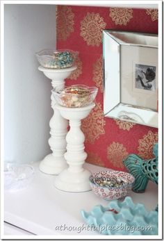jewelry nook... love the wallpapers and the antique bowls on chunky white ikea candle sticks for jewelry bowls