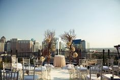 We swoon over this Dallas rooftop wedding at The Stoneleigh Hotel and the floral elements provided by Haute Floral!  Who doesn't love a cityscape? Photo by Evan Vanderwall Photography #wedding #rooftopwedding #ceremony