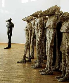 'COEXISTENCE' (2002) by Polish sculptor, Magdalena Abakanowicz (b.1930). Burlap, resin. Group of 14 pieces. via islandlass.wordpress