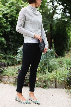 cropped black pants, leopard lace up ballet flats, turtleneck, leather clutch