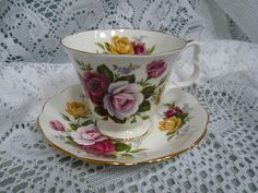 Vintage Royal Albert Cup and Saucer Circa 1960s to 1970s Yellow Red Pink Roses by TeacupsNMore on Etsy https://www.etsy.com/ca/listing/193032926/vintage-royal-albert-cup-and-saucer