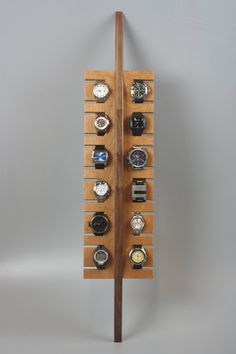 A handmade, watch display in solid walnut and cherry wood that is functional and beautiful. It holds up to 12 watches, making your daily wear