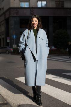 Shop this look on Lookastic:  http://lookastic.com/women/looks/crew-neck-sweater-coat-crossbody-bag-skinny-jeans-ankle-boots/9326  — Dark Green Crew-neck Sweater  — Light Blue Coat  — Black Leather Crossbody Bag  — Black Skinny Jeans  — Black Leather Ankle Boots