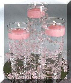 Like this idea too - and suspend a flower in there too?! Or maybe small tea votives with single buds on the table instead.