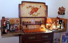 Jerralyn Ness' Prohibition-era foldout bar, with a signed painiting by Mexican artist Juan Intenoche, came from Bullock's department store in Los Angeles. The pounded brass hardware (instead of iron) was a Bullock's special order.