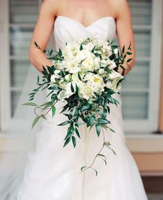 Bouquet....lots of greenery to soften industrial space Industrial-Chic Wedding | Nancy Ray Photography | blog.theknot.com