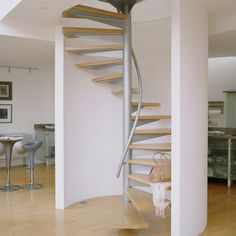 A staircase does a ton more than simply connecting different levels in your house. It may seem like a simple means of passage between floors, but if it is located in your home's front hallway… Attic Stairs, House Stairs, Spiral Staircase, Staircase Design, Staircase Ideas, Staircase Decoration, Front Hallway, Staircase Remodel, Stair Railing