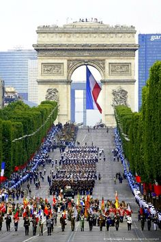 Parade at the Arc de Triomphe on the Champs Elysees in Paris, France. Go to http://www.yourtravelvideos.com/view.php?view=121173 or click on photo for video and more on this site.