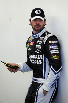Jimmie Johnson Jimmie Johnson, driver of the #48 Lowe's/Kobalt Tools Chevrolet, stands in the garage area during practice for the NASCAR Spr...
