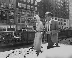 A rare candid photo of Audrey Hepburn walking in New York with Breakfast At Tiffany's co-star George Peppard.