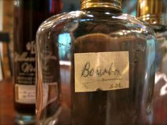 """glass flask conveniently labeled in scrawled lettering on masking tape – """"Bourbon."""" There's no arguing with that."""