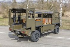 Upgraded DURO (4x4) light tactical vehicle for the Swiss Army with rear doors open to show new seats on left side of the rear troop compartment. Part of the right side is folded down to show how pallets can be loaded. (GDELS - MOWAG)
