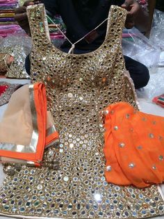 Full mirror work suit with plain dupatta and salwar get it at mytailor. Indian Suits, Indian Attire, Indian Wear, Punjabi Dress, Pakistani Dresses, Navratri Dress, Pakistani Suits, Punjabi Fashion, Indian Fashion