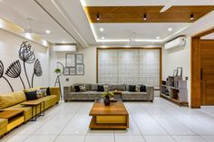 The residence portrays a very interesting strategy of using wood and It enhances the perceptual quality of the residence interior space. Living Room Partition, False Ceiling Living Room, Ceiling Design Living Room, Home Design Living Room, Home Ceiling, Living Rooms, Ceiling Ideas, Living Room Designs India, Bungalow House Design
