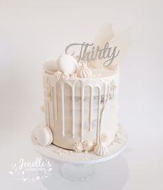 All white drip cake. By Jenelle's Custom Cakes.