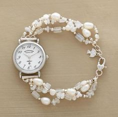 """Beaded beams of moonstones and cultured pearls emanate from a bright white timepiece. Lobster clasp. Quartz movement. Exclusive. Handcrafted in USA. Fits 7"""" to 7-1/4""""wrists"""
