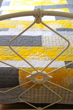 Terrific usage of yellows and grays for this modern looking quilt. Easy pattern of straight lie sewing. Easy machine quilting of swirling cross over lines that run length of color strips. Look fool proof foe the beginner! DLW