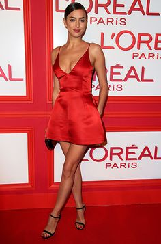 Irina Shayk wearing the Jimmy Choo Claudette sandal at the L'Oréal Paris Red Obsession Party