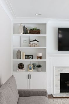white family room built-ins hold home decor and accessories. Each year we make a. white family room built-ins hold home decor and accessories. Each year we make a list of our home goals and try to tackle them during those 12 months. Alcove Ideas Living Room, Built In Shelves Living Room, Living Room Designs, White Bookshelves, Decorating Bookshelves, Living Room Cupboards, Bookcase, New Living Room, Living Room Interior