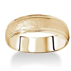 Designed with a hammered band flanked with rope designs, this band is a handsome look. Crafted of 14k yellow gold, this ring is 6 mm wide for a wide look. Metal: 14k yellow gold Finish: Hammered Metal