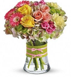 Fashionista Blooms - This arrangement would be perfect for any girl with an eye for style. It's a must-have for fashionistas everywhere. Gorgeous green hydrangea, yellow and light pink roses, pink spray roses and mini gerberas, light yellow carnations and green button spray chrysanthemums are delivered in a pretty gathering vase. #KittelbergerFlorist #RochesterFlowers
