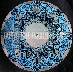 Upcycled painted vinyl record by theangrykitten.