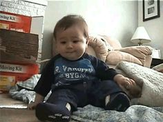 This baby laughing so hard he falls over. | 22 GIFs That Prove The World Is Not Such A Bad Place