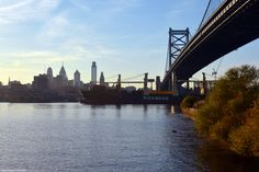 The good ship Rickmers from Seoul, passing under the Ben Franklin Bridge. Philly skyline is seen in the background.