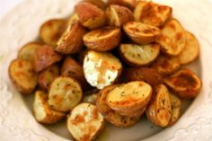 Herb-Roasted Potatoes. Made these last night, super and easy and turned beautifully! I added about a quarter of an onion for extra flavor :)