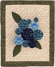 Yo Flowers by Jean Replogle.  AAQI mini quilt